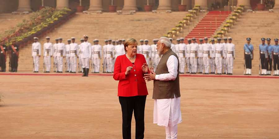 Prime Minister Narendra Modi with Germany Chancellor Angela Merkel during ceremonial reception at the Rashtrapati Bhavan in New Delhi