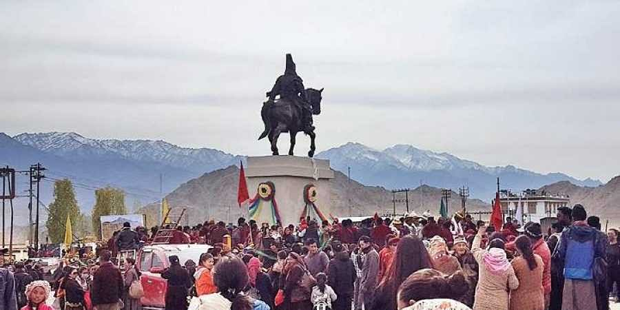 Locals cheer after the statue of Sengge Namgyal, the 17th-century Namgyal dynasty King of Ladakh, was unveiled in Ladakh on Friday