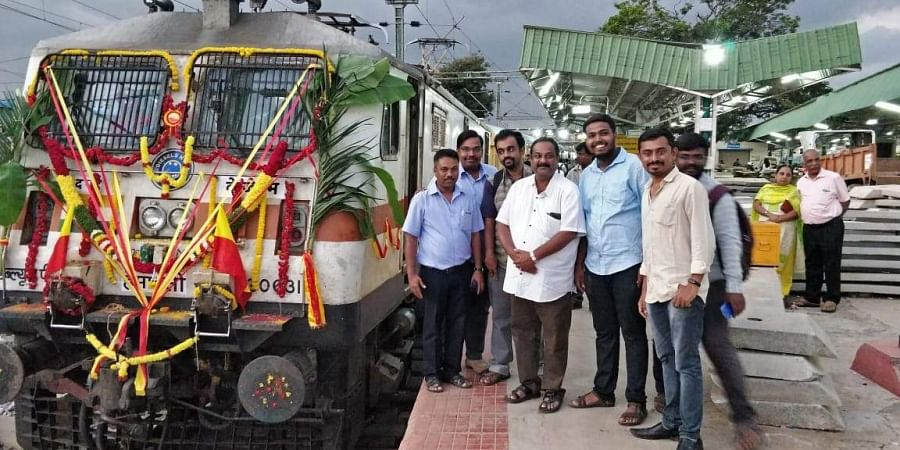 Loco pilot D Ravi with some passengers of the Chamundi Express