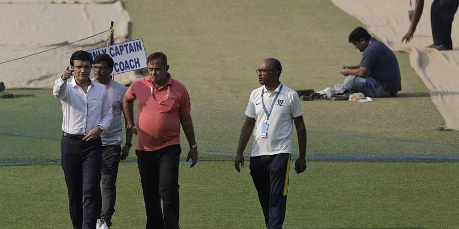 Sourav Ganguly, left, inspects the ground with other officials. (Photo | AP)