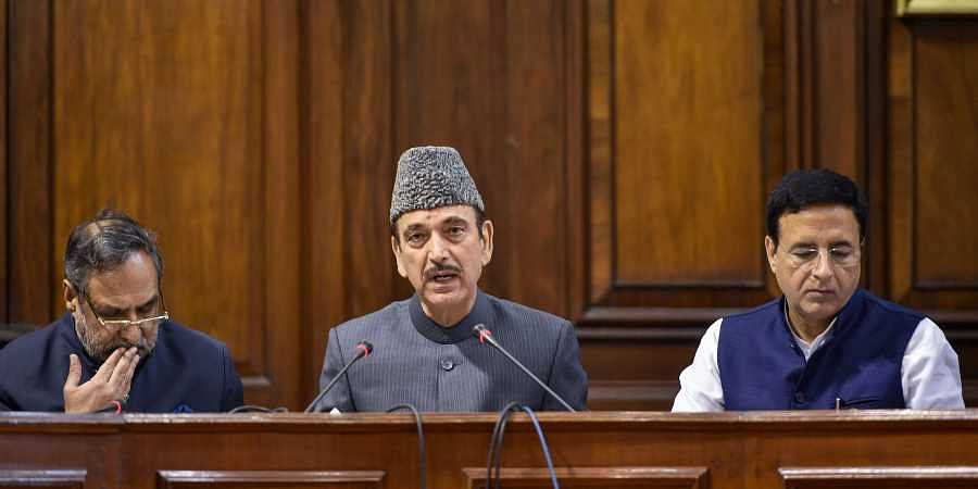 Senior Congress leaders Ghulam Nabi Azad Anand Sharma and Randeep Surjewala address the media at Parliament House during the ongoing Winter Session in New Delhi Wednesday Nov. 20 2019.