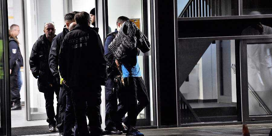 In this Tuesday, Nov. 19, 2010 photo a man is arrested by the police at a hospital in Berlin, Germany. Fritz von Weizsaecker the son of former German Richard von Weizsaecker president has been killed while he was giving a lecture at a hospital in Berlin where he also worked as a physician.