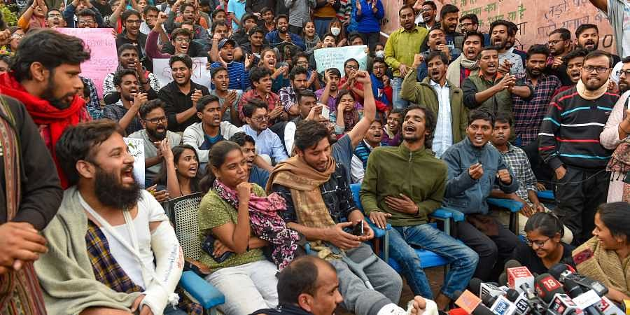 JNU students and their leaders who got injuries in Monday's police lathicharge shout slogans during a press conference at the university campus in New Delhi Tuesday Nov 19 2019.