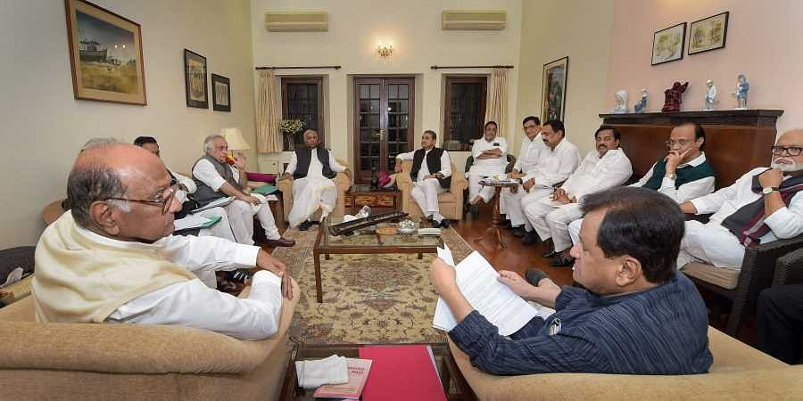 NCP chief Sharad Pawar, senior Congress leader Ahmed Patel and others during a meeting regarding government formation in Maharashtra at Pawar's residence.