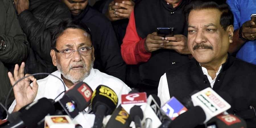 NCP leader Nawab Malik along with Congress leader Prithviraj Chavan addresses a press conference on Maharashtra government formation in New Delhi.