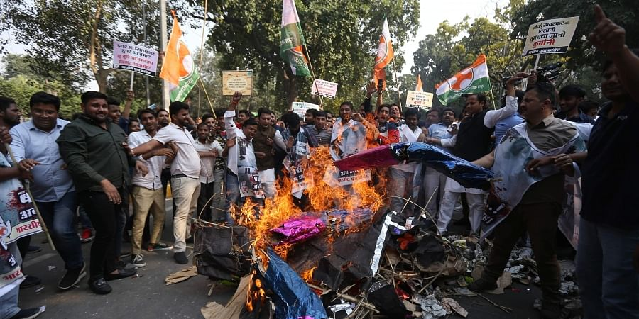 Indian Youth Congress stages a protest against the removal of SPG cover to Congress interim president Sonia Gandhi, party leaders Rahul Gandhi and Priyanka Gandhi Vadra