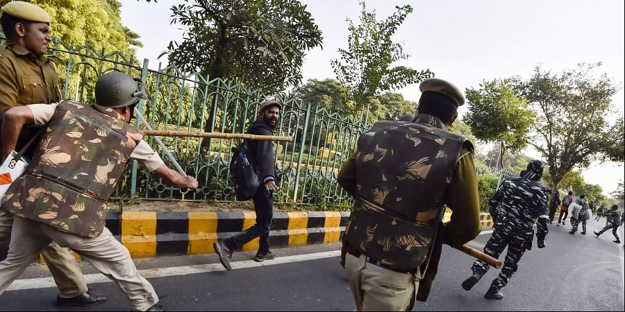 Jawaharlal Nehru University students are baton charged by police during a protest march towards Parliament.   (File  PTI)