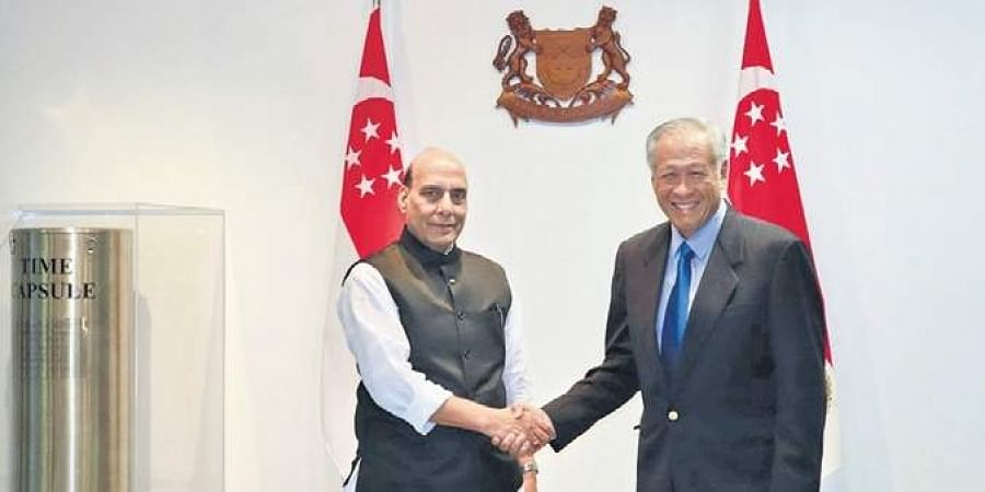 Defence Minister Rajnath Singh with his Singapore counterpart Dr NG Eng Hen in Singapore on Wednesday. | (Photo | PTI)