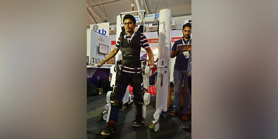 A visitor wear a Robotic Exosketelon Assisted Rehabilitation System (REARS) robot gear