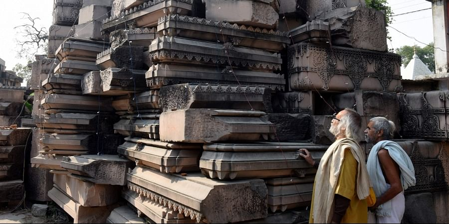 Visitors look at stone slabs carved-out for the construction of Ram Temple at Shri Ram Janmbhoomi Karyashala workshop in Karsewakpuram Ayodhya Monday Nov. 11 2019. | (Photo | PTI)
