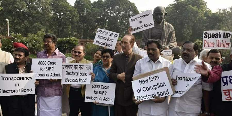 Congress MPs protesting against the Electoral bond at Parliament house in New Delhi on Friday. (Photo   Shekhar Yadav/EPS)