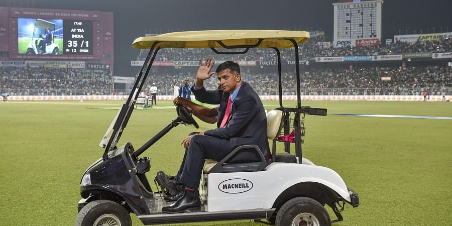 Former cricketer Rahul Dravid rides in a cart during a grand parade of India's former cricket captains. (Photo | PTI)