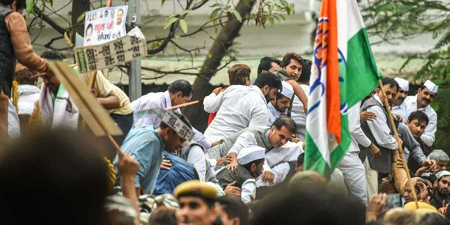 Delhi Pradesh Congress Committee leaders and supporters protest against the withdrawal of SPG security for Gandhis by the  Union Government.