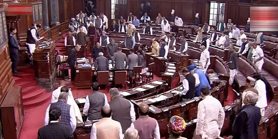 Members observe silence after an obituary reference in Rajya Sabha during Winter Session of Parliament in New Delhi Friday Nov. 22 2019.