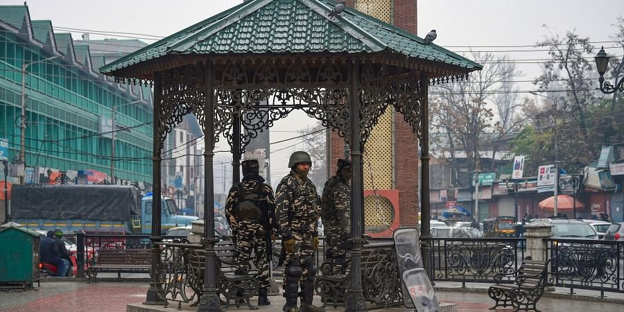 Security personnel stand guard at Lal Chowk during shutdown in Srinagar Thursday Nov. 21 2019. (Photo   PTI)