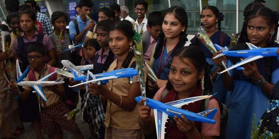 Children from Chennai orphanages at Coimbatore International Airport for a one day trip on Friday.
