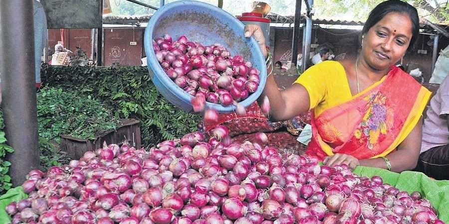 A vendor selling onions at the Patamata rythu bazar in Vijayawada on Friday