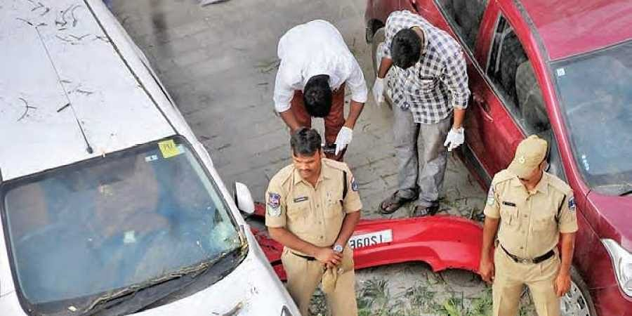Hyderabad Clues team collecting parts of the car which fell off the Biodiversity flyover in Hyderabad on Saturday.