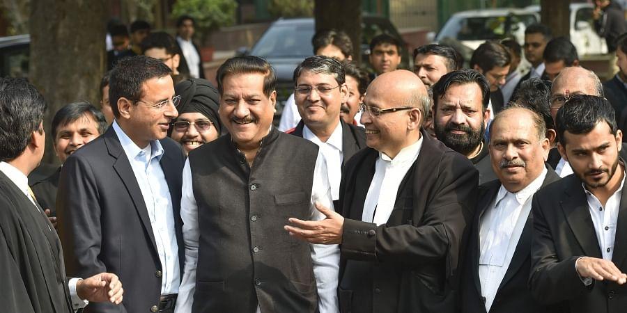 Senior Congress leaders Randeep Surjewala Prithviraj Chavan and Abhishek Manu Singhvi at Supreme Court in New Delhi Sunday Nov. 24 2019. (Photo | PTI)