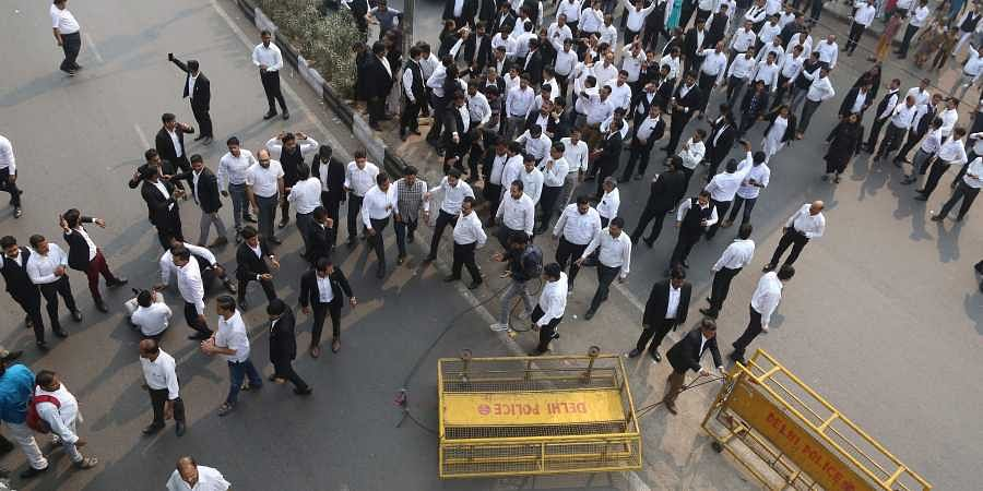 Lawyers shout slogans against Delhi Police during a protest as they block a road outiside Tis Hazari Court in New Delhi. | (File | EPS)
