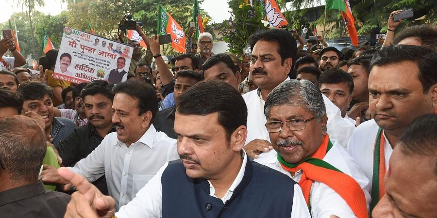 Newly sworn-in Maharashtra Chief Minister Devendra Fadnavis arrives at state's BJP office in Mumbai Saturday Nov. 23 2019. (Photo | PTI)
