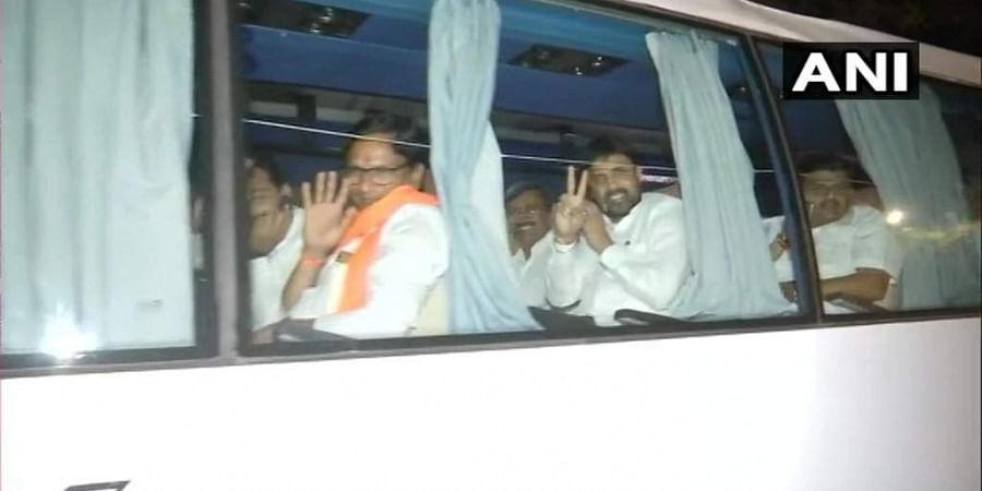 Bus carrying Nationalist Congress Party (NCP) MLAs reaches Hotel Hyatt from Hotel Renaissance, where the MLAs were lodged earlier.