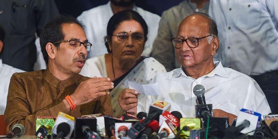 NCP President Sharad Pawar and Shiv Sena Chief Uddhav Thackeray during a joint press conference in Mumbai Saturday Nov. 23 2019. (Photo | PTI)