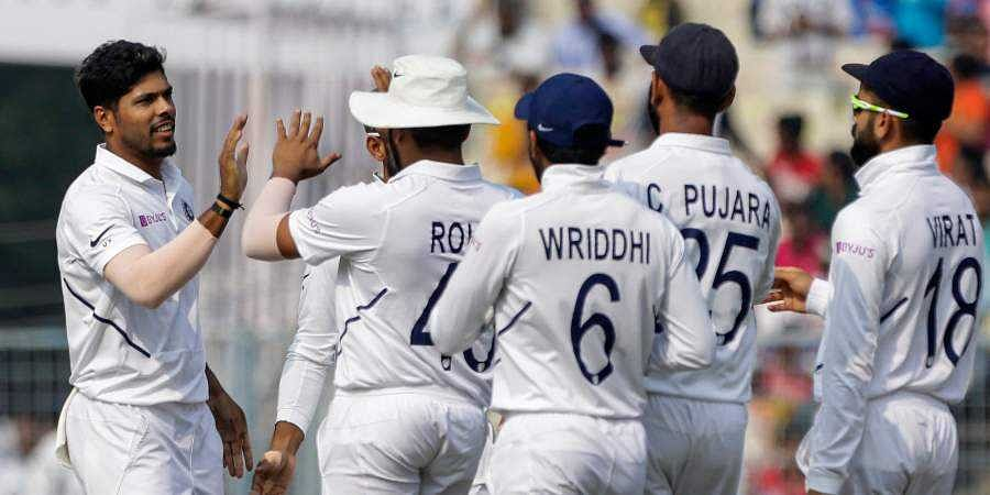 India's Virat Kohli, right, and other teammates congratulate Umesh Yadav for dismissal of Bangladesh's Ebadot Hossain during the third day of the second test cricket match between India and Bangladesh.