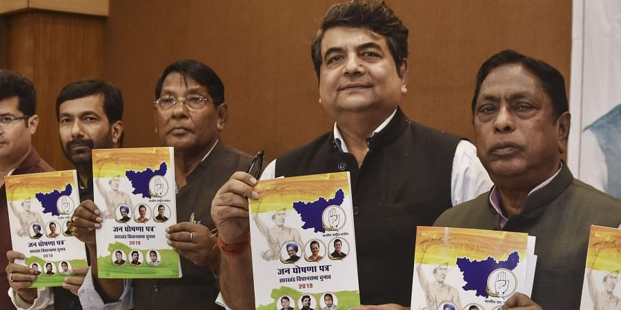 Jharkhand Congress in-charge RPN Singh state Congress President Rameshwar Oraon and others release party's manifesto for Jharkhand Assembly elections in Ranchi Sunday Nov. 24 2019.