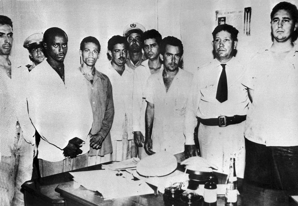 The guerrilla leader Fidel Castro (R), arrested by police, poses with a group of comrades, in July 1953, after the attack on the Moncada Garrison. The Moncada garrison house was attacked by a group led by Fidel Castro, 26 July 1953.
