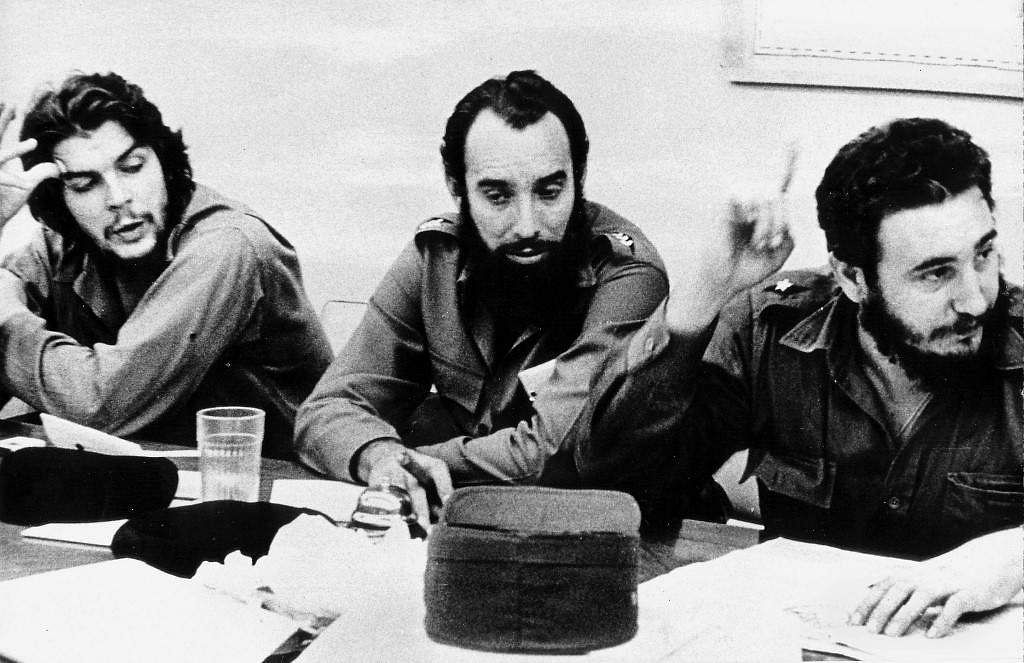 This 1960 file photo shows Cuban revolution hero Ernesto Che Guevara (L) and Cap. Antonio Nunez Jimenez (C) listening to Fidel Castro (R) at a work meeting in Havana.