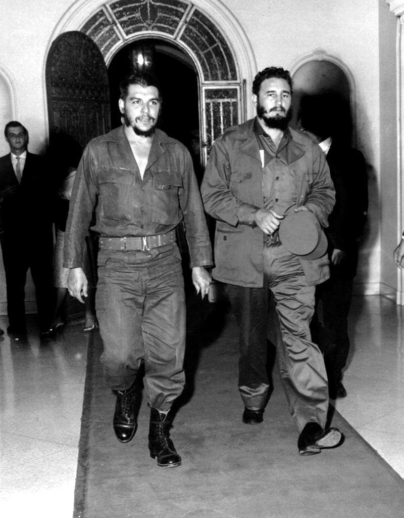 This 1963 file photo shows Argentine-born legendary revolutionary figure Ernesto Che Guevara (L) with Cuban leader Fidel Castro (R) in Havana's famous '1830' restaurant four years after he and Fidel Castro led the revolution that toppled Cuban dictator Fulgencio Batista.
