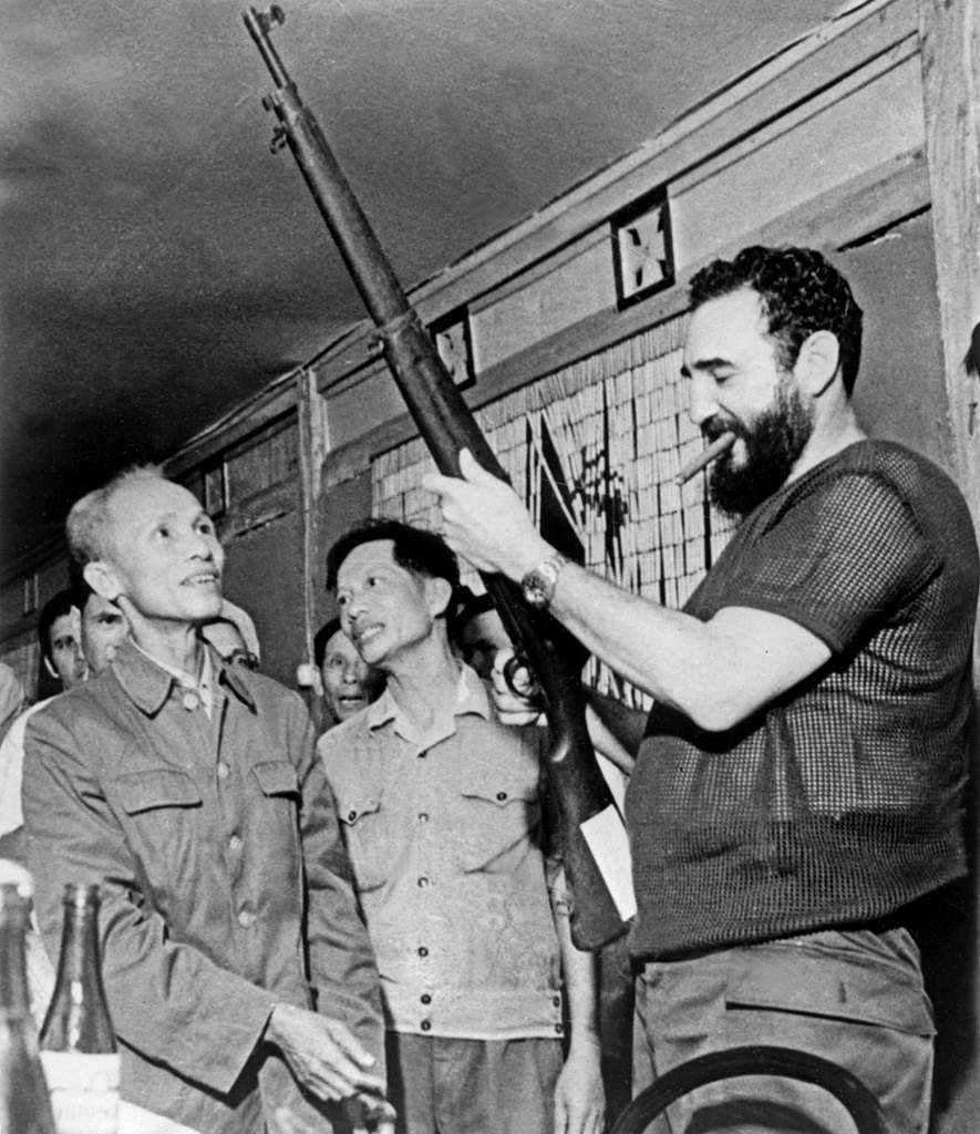 Picture dated September 1973 of Cuban president Fidel Castro (R) looking at a rifle during a visit in North Vietnam during the Vietnam war.