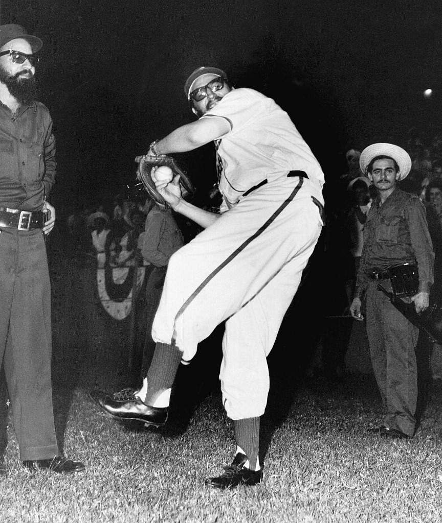 This 1959 file photo shows Cuban leader Fidel Castro (C) in a baseball uniform practicing pitching prior to a friendly game between revolutionary Cubans divided into two teams self-dubbed 'Barbudos' (the bearded ones) and 'Occidente' (the west) in Havana.