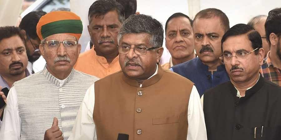 Union Ministers Ravi Shankar Prasad Arjun Ram Meghwal and Pralhad Joshi address the media at Parliament House in New Delhi Monday