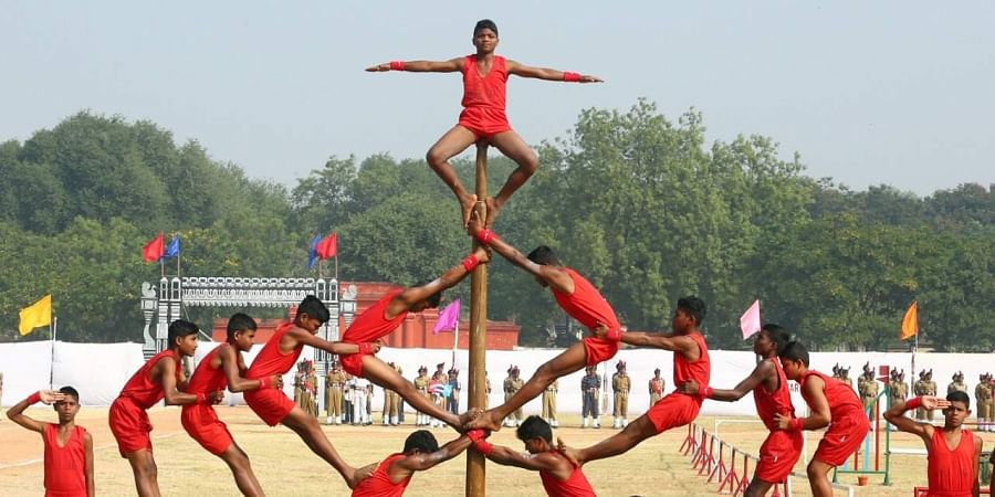 Hyderabad NCC cadets perform Malkamb during NCC Day celebrations at Parade Ground Secunderabad on Sunday.