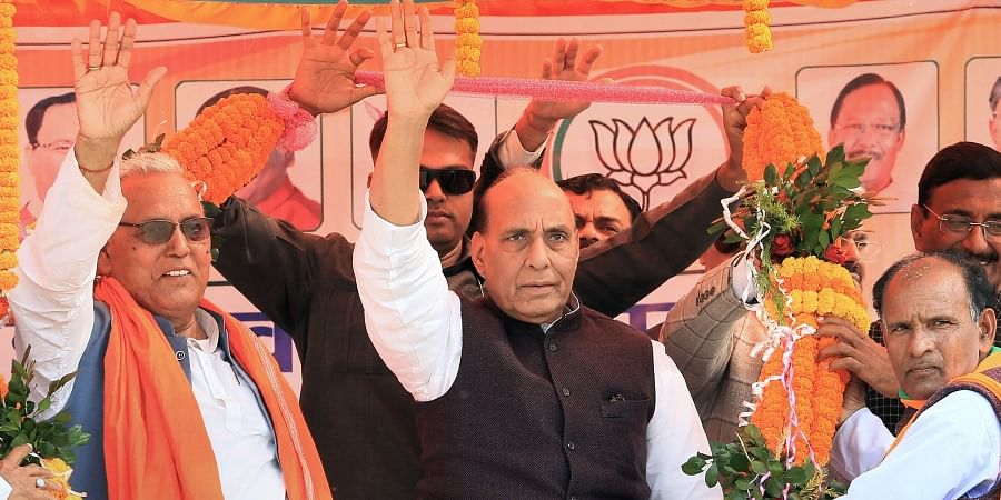 Union Defence Minister Rajnath Singh being garlanded during an election rally for the forthcoming Assembly Election-2019 in Palamau district Jharkhand Sunday Nov. 24 2019. (Photo | PTI)