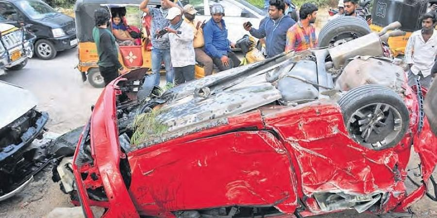 The mangled remains of the car that fell off Biodiversity flyover on Saturday