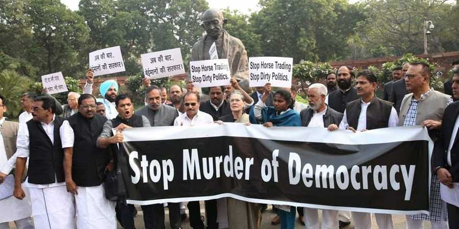 Congress President Sonia Gandhi leads a protest against Maharashtra government formation issue at Parliament premises in New Delhi