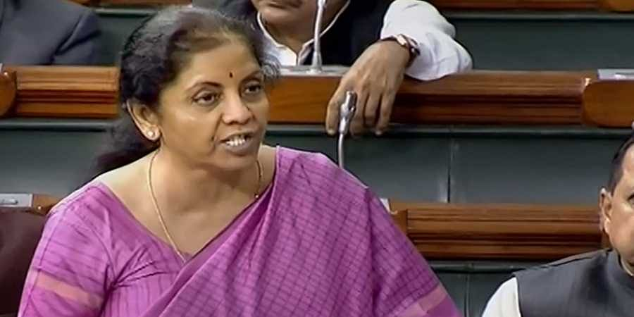 inance Minister Nirmala Sitharaman speaks in the Lok Sabha during the Winter Session of Parliament in New Delhi Monday