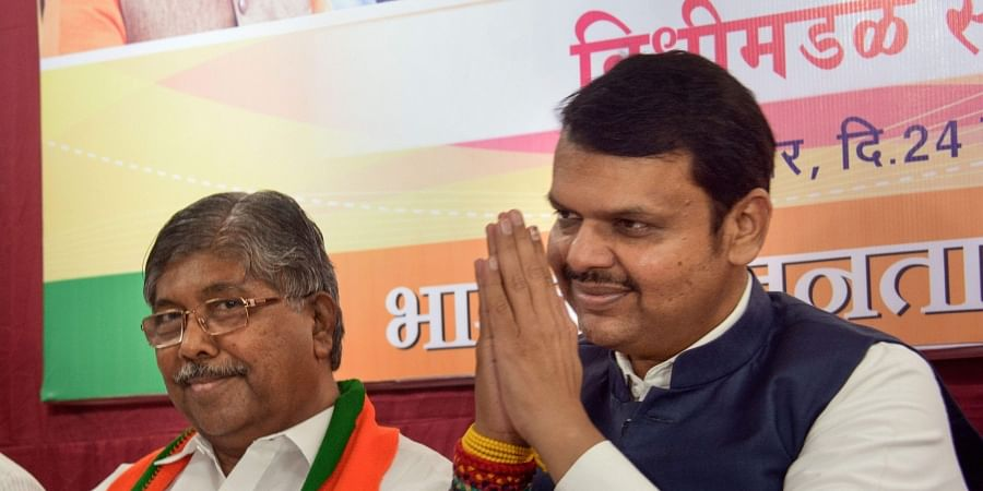 Maharashtra Chief Minister Devendra Fadanvis (R) and BJP state president Chandrakant Patil during party MLAs meeting at Vasant Smruti, Mumbai, Sunday Nov.24 2019. (Photo   PTI)