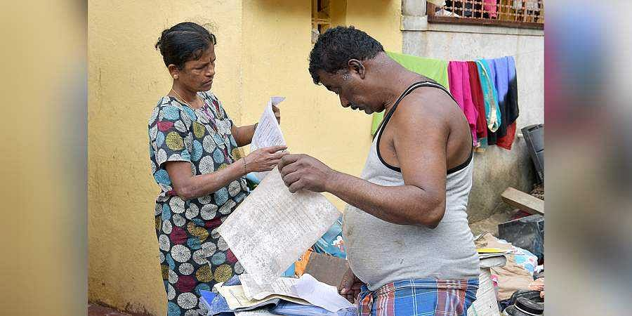 Residents dry out their documents and belongings on Monday.