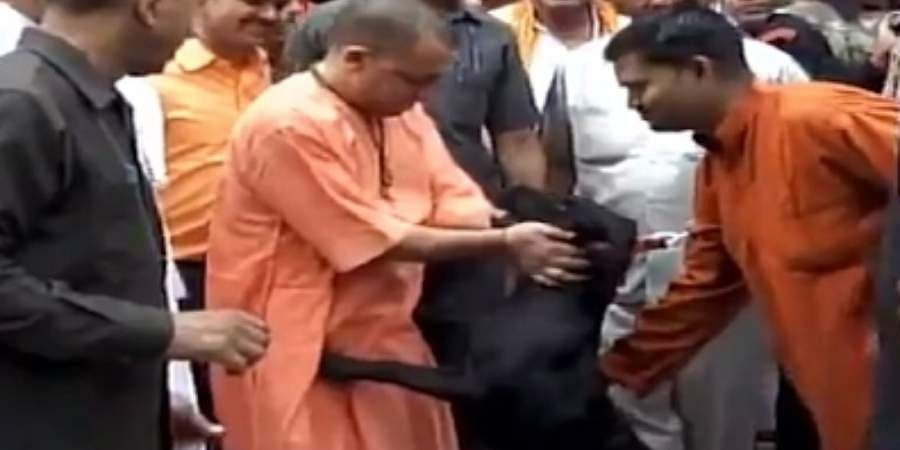 Uttar Pradesh Chief Minister Yogi Adityanath with his pet dog Kalu.