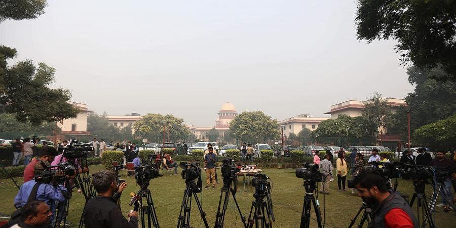 File photo of reporters outside Supreme Court.