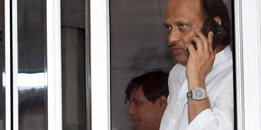 NCP leader Ajit Pawar talks over the phone as he arrives at Maharashtra Vidhan Bhawan in Mumbai Wednesday Nov. 27 2019. (Photo | PTI)