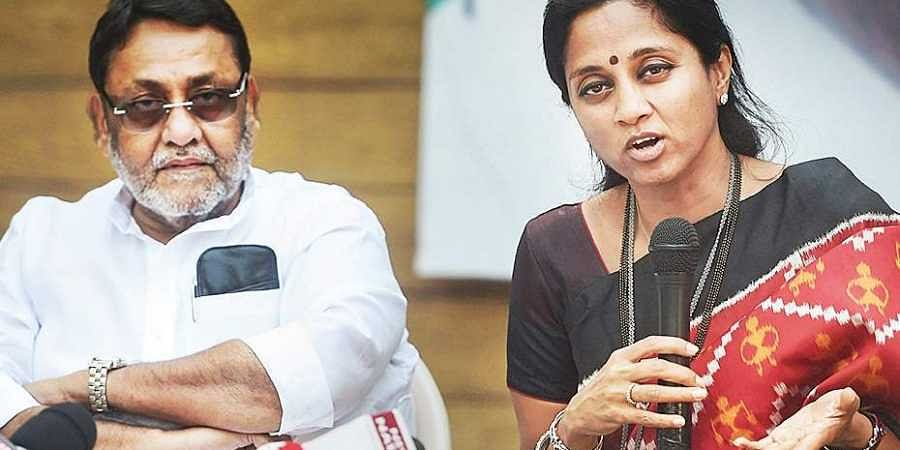 Nationalist Congress Party spokesperson Nawab Malik with Supriya Sule at a press conference.