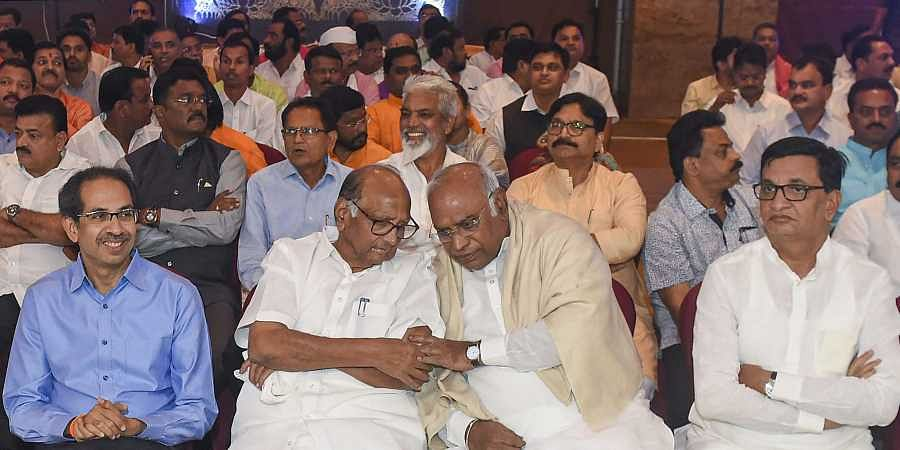 Senior Congress leader Mallikarjun Kharge NCP chief Sharad Pawar and Shiv Sena President Uddhav Thackeray Balasaheb Bhausaheb Thorat along with NCP Congress and Shiv Sena MLAs during a gathering to display their strength of 162 at Grand Hyatt Hotel in Mumbai Monday Nov. 25 2019. (File | PTI)