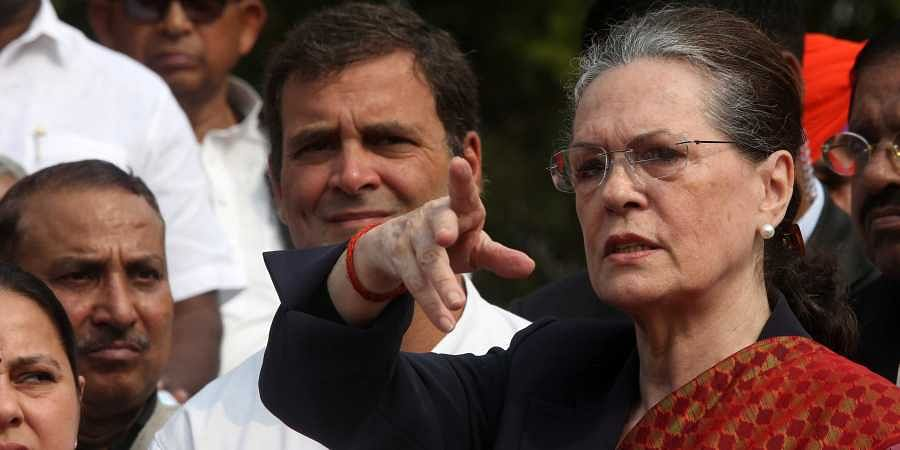 Congress interim President Sonia Gandhi, party leader Rahul Gandhi with Opposition party members take part in a demonstration to protest BJP's move to form the government in Maharashtra in the Parliament House in New Delhi on Tuesday November 26 2019. (Photo | Shekhar Yadav/EPS)