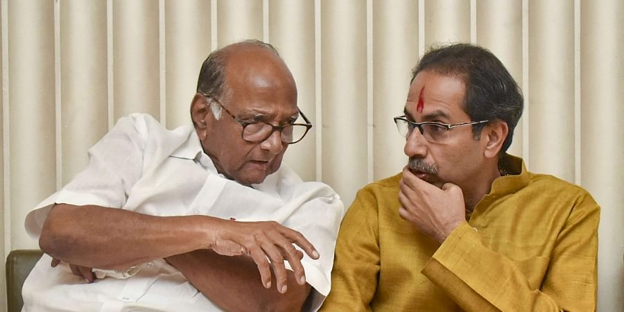 Shiv Sena President Uddhav Thackeray with NCP chief Sharad Pawar after he was chosen as the nominee for Maharashtra chief minister's post by Shiv Sena-NCP-Congress alliance during a meeting in Mumbai Tuesday Nov. 26 2019. (Photo | PTI)