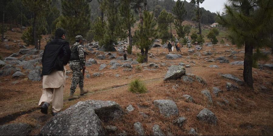 Pakistani reporters and troops visit the site of an Indian airstrike in Jaba, near Balakot, Pakistan. (File| AP)
